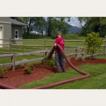 Red Coloured Mulch installation into residential landscaping