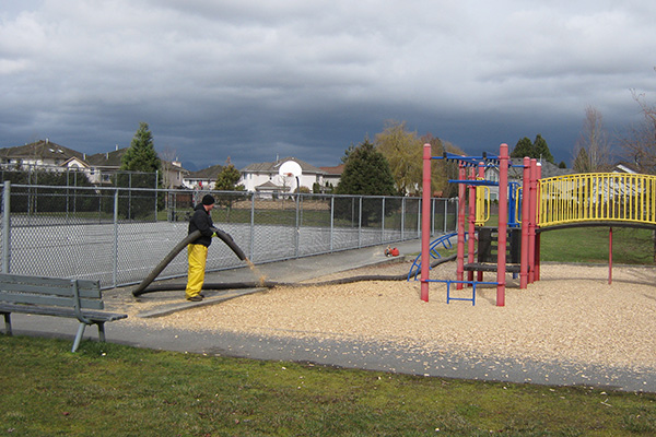Playground wood chip installation