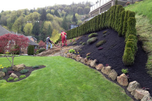 black mulch installation with blower truck