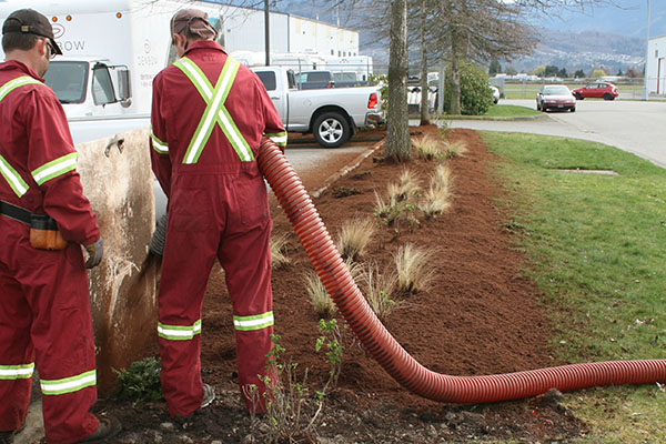 Blower Truck Services laying landscape mulch