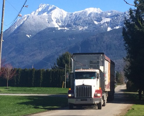 Denbow Transport Truck with snow-covered Mt. Cheam in background