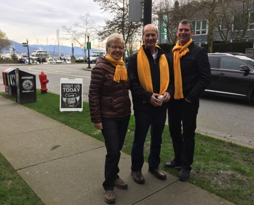 Margaret Dunn, Joe Neels and Steve Heppel serving egg sandwiches In Vancouver