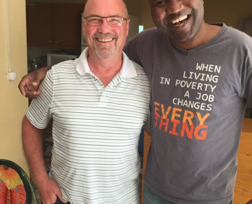 Bill Boesterd, President of Denbow, coaching business owners in Haiti