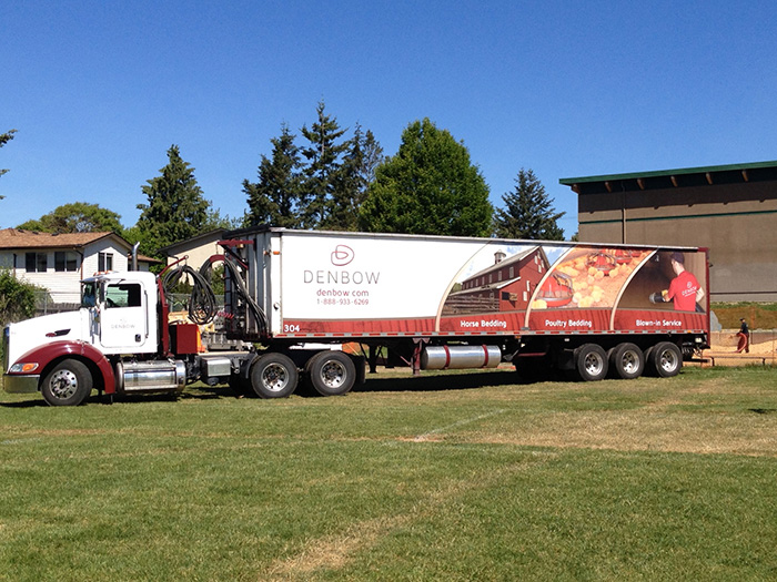 Denbow blower truck installing playground wood chips in Victoria