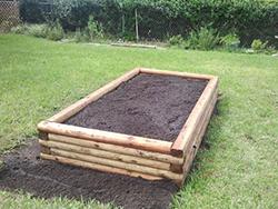 raised garden bed from interlocking landscaping ties